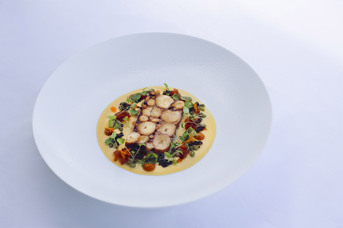Image of SENSE Restaurant dish with octopus terrine, Red pepper cream with vinegar, oregano, Feneos fava with mung beans, sweet & sour Florina red pepper