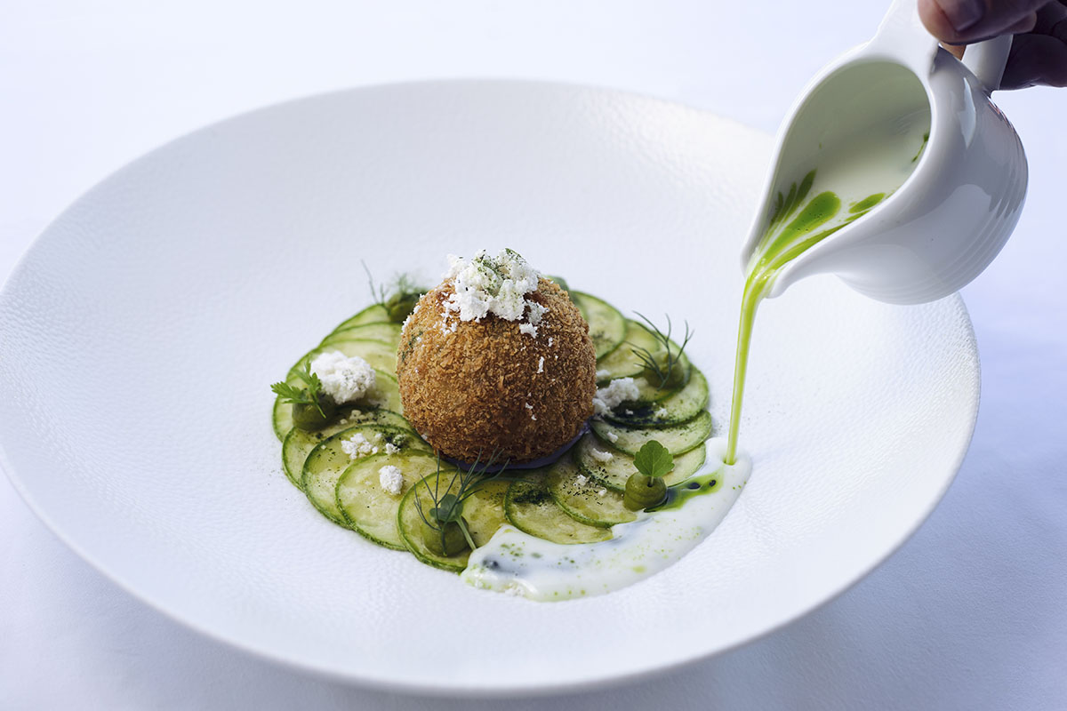 Image of SENSE Restaurant dish zucchini ball, buttermilk, fresh herbs, dill oil, early harvest olive oil powder